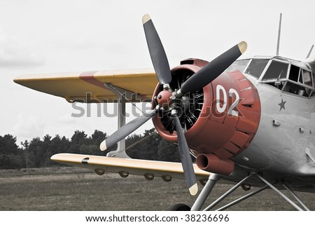desaturated photo of old military plane waiting for airborne