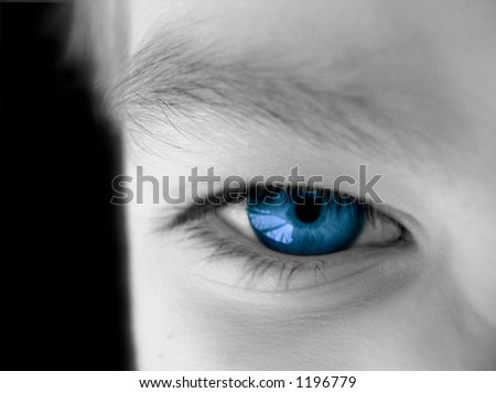 desaturated view of part of a human face with the eye left in color - stock photo