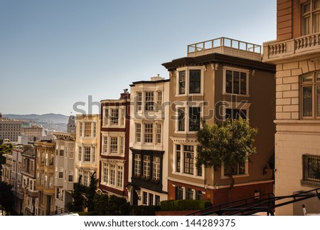 Descending row of stately houses on hill in San Francisco