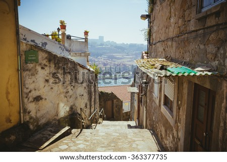 Descent old alley in Porto with a view to the river Douro. - stock photo