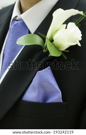 Description: Close up of a Groom wearing a white rose buttonhole Location: Corsham, Wiltshire, UK Taken: 15/03/08 - stock photo
