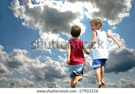 Description: Two boys holding hands running up to heaven - stock photo