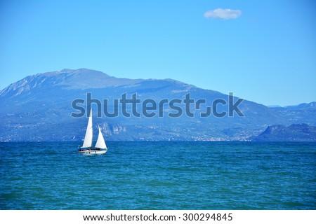 Desenzano del Gardaâ?? town Italy lake and yacht landscape - stock photo