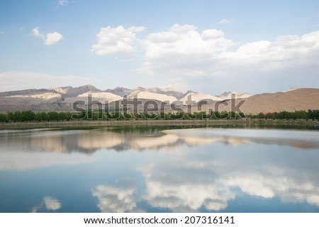 desert and lake scenery,Inner Mongolia,china - stock photo