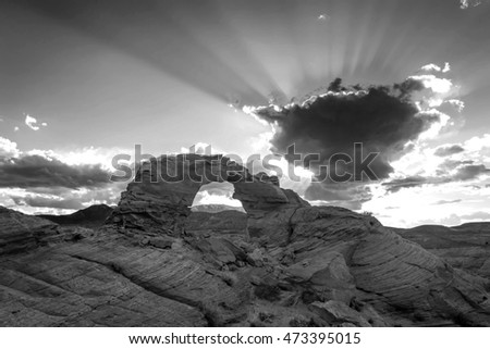 Desert arch and dramatic sky in black and white, Utah, USA.