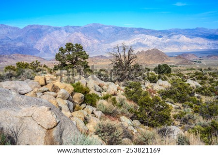 "Desert area near the Alabama Hills.Alabama Hills are a ""range of hills"" and rock formations near the eastern slope of the Sierra Nevada Mountains in the Owens Valley, California. - stock photo"