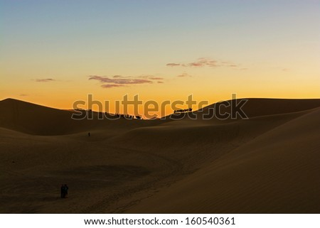 Desert, Camel Ride, Enjoying and happy People - stock photo