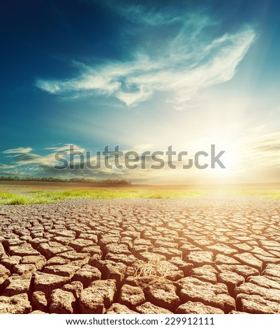 desert earth and dramatic sky with sunset - stock photo