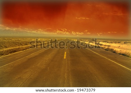 Desert Highway: Road travelling through a desert Field at Sunset?5? - stock photo