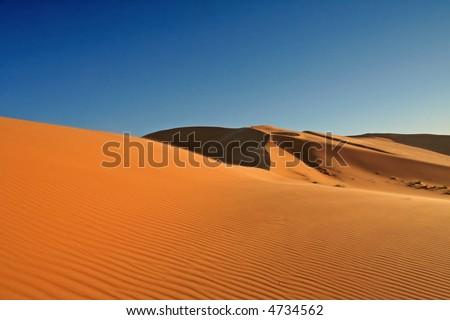 Desert in Hasi Labied, Moroco, Africa. Interesting colored sand dunes. Popular travel destination. - stock photo
