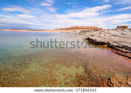Desert Lake - Colorful desert lake and its sandstone rocky shore. Lake Powell, Glen Canyon National Recreation Area, Page, Arizona, USA.