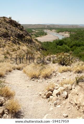 desert landscape and Rio Grande river - stock photo