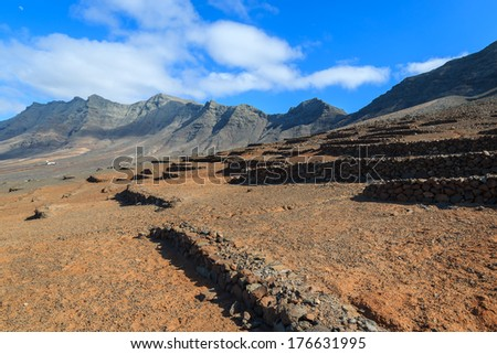 Desert landscape near Cofete beach and volcanic mountains view on Jandia peninsula, Fuerteventura, Canary Islands, Spain