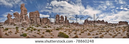 Desert landscape sand rock formation formed by wind erosion panorama of Bolivian alti plano wild west eroded rocks majestic scenic remote dry arid nature area in Andes South America - stock photo