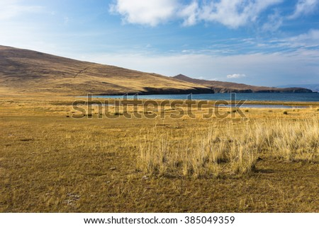 Desert landscape. View from island Olkhon to lake Baikal. - stock photo