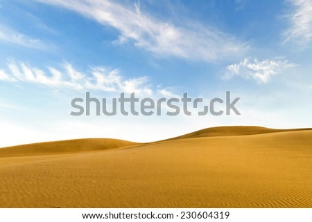 desert landscape with blue sky. Dunes background - stock photo