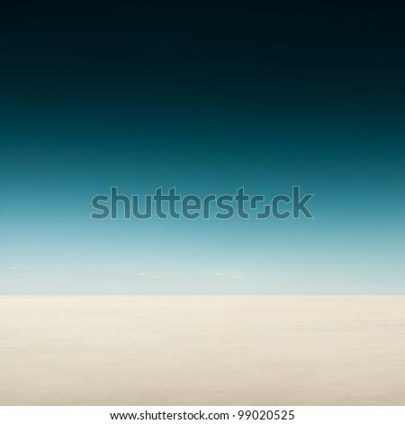 Desert landscape with dark sky - stock photo