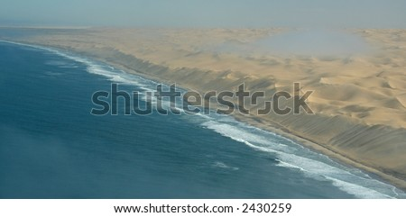 Desert meets the Sea - stock photo