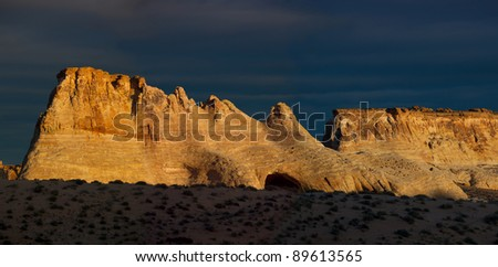 Desert mesa at sunrise with cave showing - stock photo
