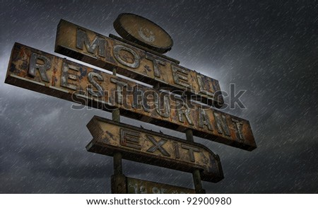 Desert Motel Sign In a Storm - stock photo
