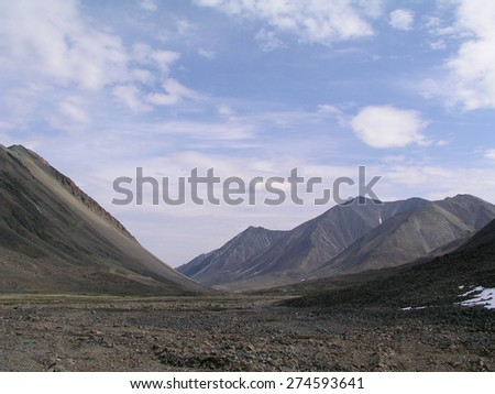 Desert Mountain and clouds in the sky - stock photo