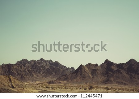 Desert Mountain - Post-production added grain and effects - stock photo