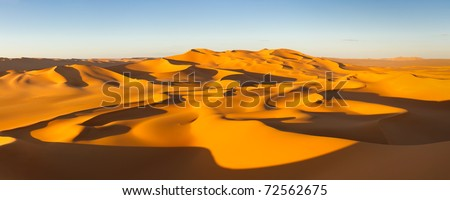 Desert Panorama - Endless sand dunes at sunset - Murzuq Desert, Sahara, Libya - stock photo