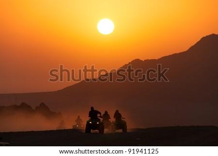 Desert quad in the sunset, Sharm-el-Sheikh, Sinai desert - stock photo