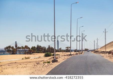 Desert road in Aswan, Egypt. - stock photo