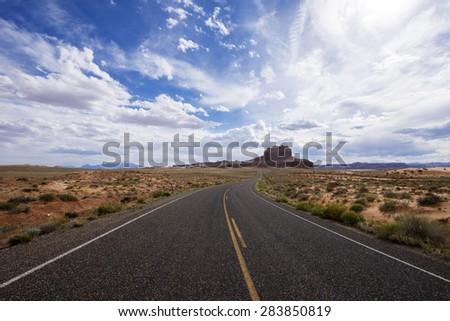Desert road in southern Utah. - stock photo