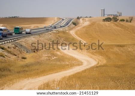 desert road near highway - stock photo