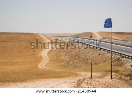 desert road near the highway - stock photo