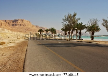 Desert road on the way to the Dead sea hotel area, Israel - stock photo