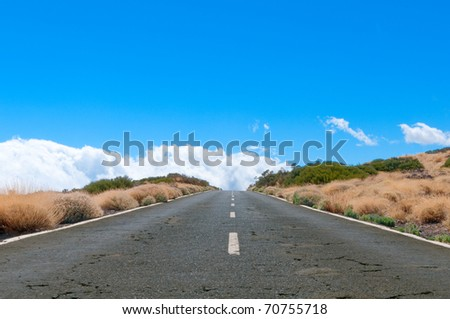 Desert road stretching into the horizon on Lanzarote, Canary island, Spain - stock photo