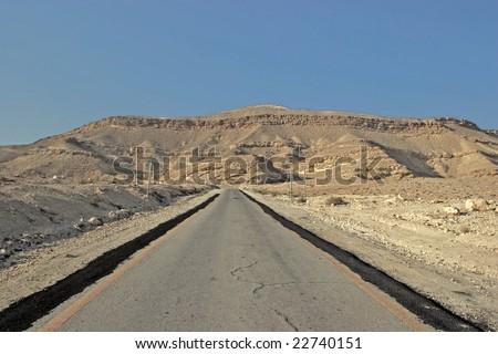 desert road to the mountains - stock photo