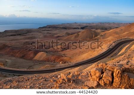 desert road waving in the mountains of Jordan near Dead Sea coast - stock photo