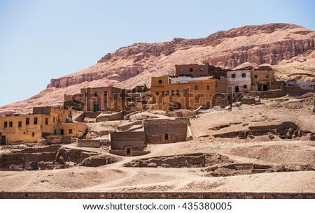 Desert rock town. Houses on the slopes West Bank, Luxor, Egypt - stock photo
