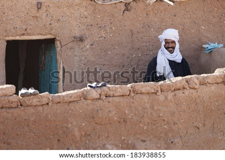DESERT SAHARA, MOROCCO - MARCH 3: Unidentified person, portrait of male muslim March 3, 2014. Desert Sahara is the world's hottest desert, and the third largest desert in Morocco. - stock photo