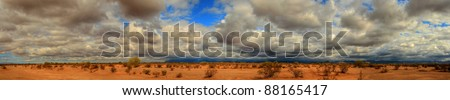Desert storm over the southwestern desert and mountains panorama - stock photo