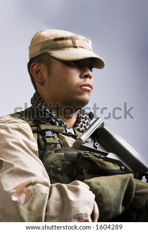 desert storm soldier in the army dressed in camo head shot - stock photo