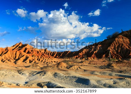 desert, sunset in desert, tatacoa desert, columbia, latin america, clouds and sand, red sand in desert - stock photo