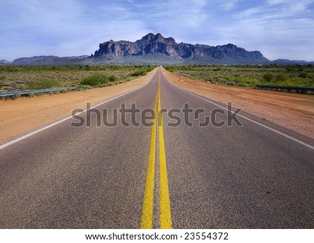Desert wilderness road leading to mountain.
