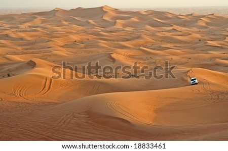 Desert with a single car in the United Arabian Emirates - stock photo