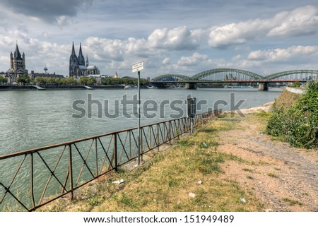 Deserted and derelict waterfrontage beside the river Rhine and the German city of Cologne. - stock photo