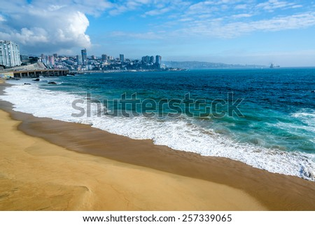 Deserted beach and beautiful turquoise Pacific Ocean water in Vina del Mar, Chile - stock photo