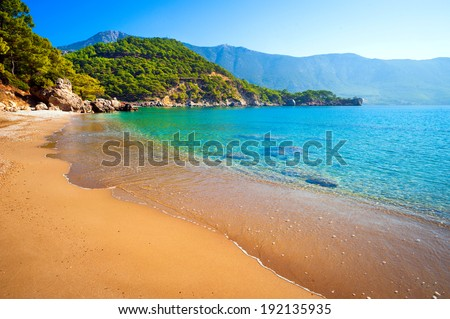 deserted beach, sea, sun, sky and sand - it's perfect! - stock photo