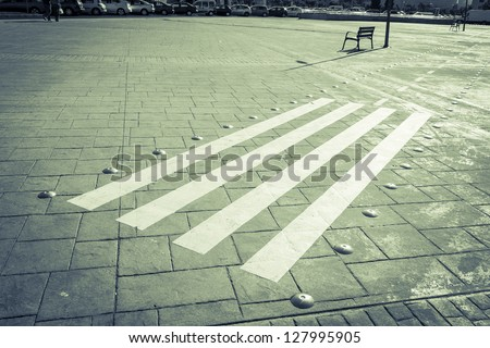 Deserted bicycle lane with zebra crossing in the middle of a square - Leon, Spain. - stock photo