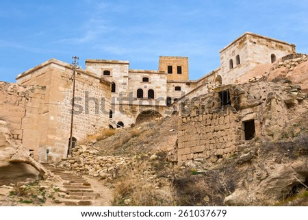 Deserted cave town in Cavusin, Cappadocia, Turkey - stock photo