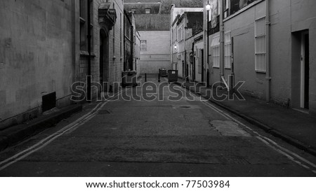 Deserted Dark Alley at Night in an Inner City - stock photo