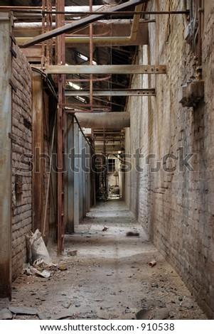 deserted hall inside factory - stock photo